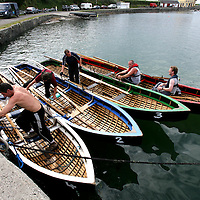 Currachs lined up at the pier in Kilbaha during the Currach Racing at the Kilbaha Festival on Sunday.<br /><br />Photograph  by Eamon Ward