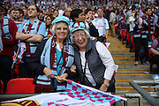Two lady Aston Villa fans during the The FA Cup match between Arsenal and Aston Villa at Wembley Stadium, London, England on 30 May 2015. Photo by Phil Duncan.