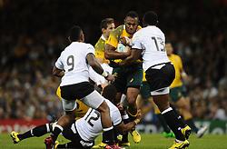 Fiji Outside Centre Vereniki Goneva tackles Australia Outside Centre Tevita Kuridrani  - Mandatory byline: Joe Meredith/JMP - 07966386802 - 23/09/2015 - Rugby Union, World Cup - Millenium Stadium -Cardiff,Wales - Australia v Fiji - Rugby World Cup 2015 - Pool A