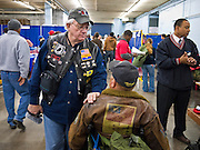 04 FEBRUARY 2011 - PHOENIX, AZ: An Arizona StandDown volunteer greets a veteran at the Arizona StandDown in Phoenix Friday. The Arizona StandDown is an annual three day event that brings together the Valley's homeless and at-risk military veterans, connecting them with services ranging from: VA HealthCare, mental health services, clothing, meals, emergency shelter, transitional and permanent housing, ID/ drivers license's, court services and Legal Aide, showers, haircuts and myriad other services and resources.  Arizona StandDown is held annually at the Veterans Memorial Coliseum at the Arizona State Fairgrounds in Phoenix on Super Bowl weekend.    Photo by Jack Kurtz