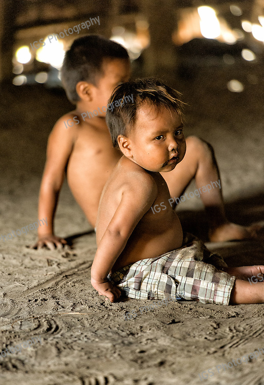 Children of the Yagua Tribe  play inside the Maloca