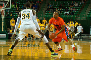 WACO, TX - JANUARY 3: Deven Williams #20 of the Savannah State Tigers brings the ball up court against the Baylor Bears on January 3, 2014 at the Ferrell Center in Waco, Texas.  (Photo by Cooper Neill) *** Local Caption *** Deven Williams