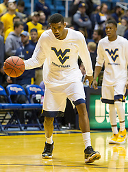 Feb 13, 2016; Morgantown, WV, USA; West Virginia Mountaineers forward Jonathan Holton (1) warms up before their game against the TCU Horned Frogs at the WVU Coliseum. Mandatory Credit: Ben Queen-USA TODAY Sports