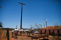 CAETITE, BRAZIL - OCTOBER 25, 2013:<br /> Areldo Silva, 57, right, with his father Florisvaldo, 83, left, and their family, agreed to be paid $250 a month to permit Renova Energia with wind turbines on their 46-acre land. A string of wind-turbine parks, in the municipal of Caetite, are being erected in the windiest stretches of Bahia state, Brazil, on Friday, Oct 25, 2013. <br /> (Photo by Lianne Milton/For The Washington Post