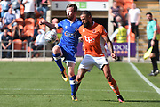 Blackpool Forward, Kyle Vassell (7) ans Oldham Athletic Defender,  Cameron Dummigan (2) during the EFL Sky Bet League 1 match between Blackpool and Oldham Athletic at Bloomfield Road, Blackpool, England on 26 August 2017. Photo by Mark Pollitt.