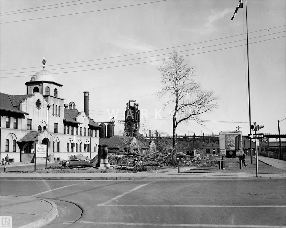 A view of the MInnequa Works Main Office complex showing the chopping down of the trees in the promenade in front of the building.<br /> Date: 1-10-56<br /> Stamped &quot;Blast &amp; Publicity Department&quot; <br /> Women working at tabulating machines in Administrative Annex building.<br /> Date: 1953<br /> Stamped verso &quot;Credit Photo CF&amp;I Blast Pueblo, Colo.&quot;<br /> Prints Admin Pueblo Box 8