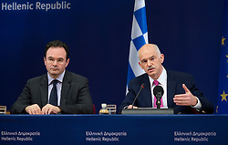 George Papandreou, Greece's prime minister, right, speaks as George Papaconstantinou, Greece's finance minister, listens, during a news conference following the European Summit, in Brussels, on Friday, March 26, 2010. (Photo © Jock Fistick)