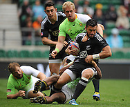 LONDON, ENGLAND - Sunday 11 May 2014, Sherwin Stowers of New Zealand is caught by Branco du Preez of South Africa during the Cup quarter final match between South Africa and New Zealand at the Marriott London Sevens rugby tournament being held at Twickenham Rugby Stadium in London as part of the HSBC Sevens World Series.<br /> Photo by Roger Sedres/ImageSA