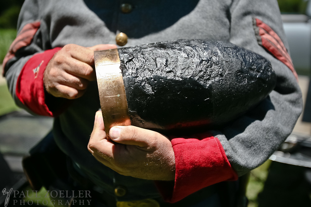 "JAMES ISLAND, SC - JULY 18: Reenactor Keith Purdy, of Charleston holds a 6.4 "" Harding Shell like the ammunition used during the Civil War at at Seashore Farmers' Lodge on James Island. (Photo by Paul Zoeller/For the Washington Post)"