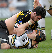 Wycombe, GREAT BRITAIN,  First half, love in as Wasps's Rob WEBBER, on top, and Saints Euen MURRAY engage in a full and frank discussion after a scrum, during the first half of the  Guinness Premiership rugby game, London Wasps vs Northampton Saints, at Adam's Park Stadium, Bucks, England, on Sun 22.02.2009. [Photo, Peter Spurrier/Intersport-images]