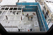 dismantling of a metal frame commercial building during winter in Nagano Japan