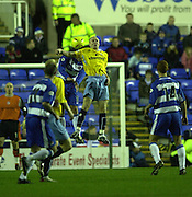20/12/2003 - Photo  Peter Spurrier.2003_04_Nationwide_Div_1.Reading_FC_vs_Crystal_Palace_FC.Palace's Andrew Johnson [centre] out jumps the Reading defence.