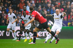 Swansea Midfielder Jonjo Shelvey (ENG) crosses during the first half of the match - Photo mandatory by-line: Rogan Thomson/JMP - Tel: Mobile: 07966 386802 17/08/2013 - SPORT - FOOTBALL - Liberty Stadium, Swansea -  Swansea City V Manchester United - Barclays Premier League - First round of the 2013/14 season and the first league match for new Man Utd manager David Moyes.