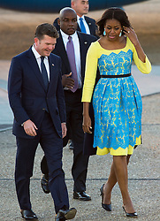 © Licensed to London News Pictures. 15/06/2015. Stansted, UK. First Lady MICHELLE OBAMA is greeted by U.S. Ambassador to th UK, Matthew W. Barzun (far left), as she arrives in the UK at Stansted Airport accompanied by her daughters Malia and Sasha for the start of a three day visit to the UK. During the visit the First Lady and her family will meet with students at Mulberrry School for Girls and have Tea with Prime Minister David Cameron and Samantha Cameron. Photo credit: Ben Cawthra/LNP