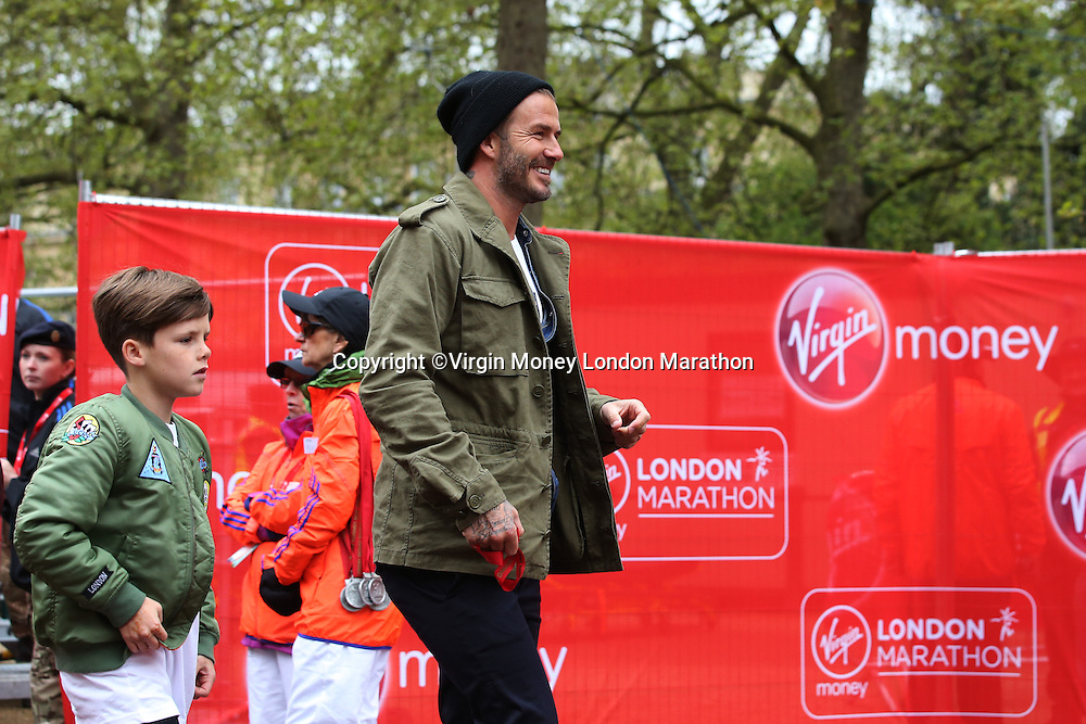 Mini London marathon 2015, The Borough Challenge Boys Under 13 race. David and Cruz Beckham with the rest of their family wait for Romeo Beckham (12) at the finish line on The Mall. The Virgin Money Giving Mini Marathon, Sunday 26th April 2015.<br />