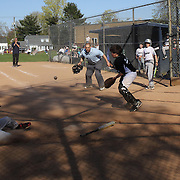 The umpire watches a play a home plate during the Norwalk Little League baseball competition at Broad River Fields,  Norwalk, Connecticut. USA. Photo Tim Clayton