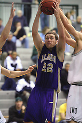 30 December 2006: Andrew Holms pulls a rebound away from a Titan. The Titans outscored the Britons by a score of 94-80. The Britons of Albion College visited the Illinois Wesleyan Titans at the Shirk Center in Bloomington Illinois.<br />