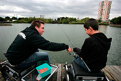 UK ENGLAND LONDON 10AUG06 - Thames 21 Angling Coach Jack Stephens (L) introduces an inner-city child to the secrets of angling. Thames 21 Angling Development Project at Canada Water Dock, London seeks to introduce and involve inner-city children with angling around various locations in London...jre/Photo by Jiri Rezac..© Jiri Rezac 2006..Contact: +44 (0) 7050 110 417.Mobile:  +44 (0) 7801 337 683.Office:  +44 (0) 20 8968 9635..Email:   jiri@jirirezac.com.Web:    www.jirirezac.com..© All images Jiri Rezac 2006 - All rights reserved.