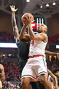 LUBBOCK, TX - MARCH 1: Shadell Millinghaus #4 of the Texas Tech Red Raiders goes to the basket against Andrew Jones #1 of the Texas Longhorns during the game on March 1, 2017 at United Supermarkets Arena in Lubbock, Texas. Texas Tech defeated Texas 67-57. (Photo by John Weast/Getty Images) *** Local Caption *** Shadell Millinghaus;Andrew Jones