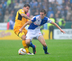 Bristol Rovers' Tom Lockyer is tackled by Newport County's Danny Crow  - Photo mandatory by-line: Dougie Allward/JMP - Tel: Mobile: 07966 386802 17/08/2013 - SPORT - FOOTBALL - Rodney Parade - London - Newport County V Bristol Rovers - Sky Bet league two