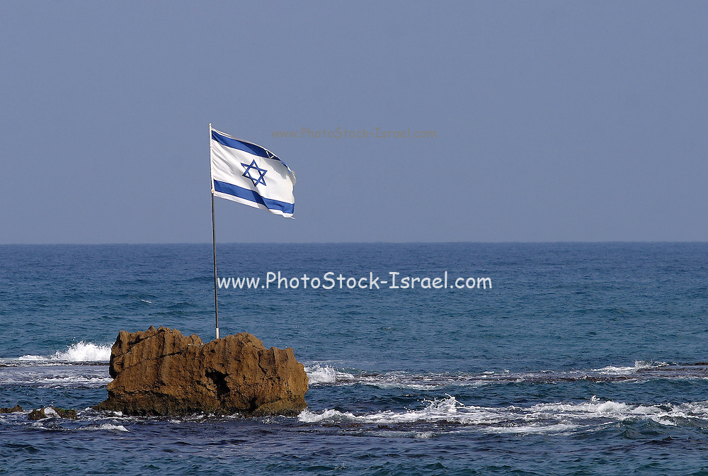 Israeli flag on a rock at the entrance to the old port of Jaffa