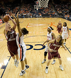 BC's Kathrin Ress (11) shoots over UVA's Lyndra Littles (1).  The Cavaliers defeated the Eagles 65-63 in overtime at the John Paul Jones Arena in Charlottesville, VA on January 14, 2007.