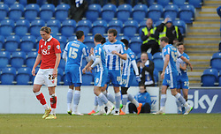 Bristol City's Luke Ayling cuts a dejected figure as Colchester United's Macauley Bonne celebrates with his team mates after scoring. - Photo mandatory by-line: Dougie Allward/JMP - Mobile: 07966 386802 - 21/02/2015 - SPORT - Football - Colchester - Colchester Community Stadium - Colchester United v Bristol City - Sky Bet League One