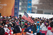 PYEONGCHANG-GUN, SOUTH KOREA - FEBRUARY 14: An American flag over the crowd during the Mens Snowboard Halfpipe competition at Phoenix Snow Park on February 14, 2018 in Pyeongchang-gun, South Korea. Photo by Nils Petter Nilsson/Ombrello               ***BETALBILD***