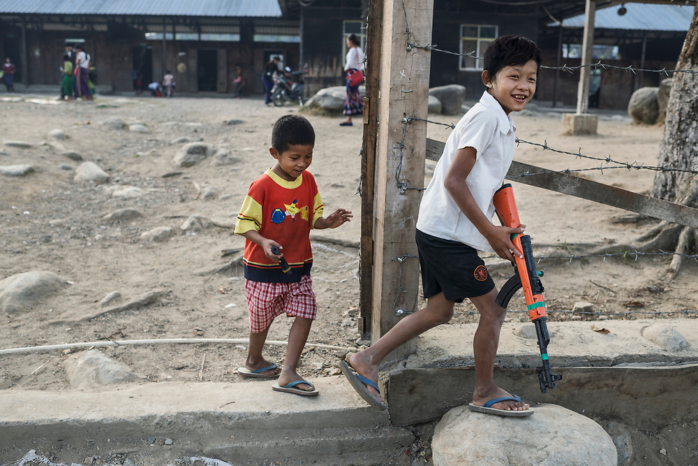 Laiza, Myanmar 20180119 <br /> Children with toy guns play in the schoolyard at Je Yang IDP camp.<br /> Photo: Vilhelm Stokstad / Kontinent