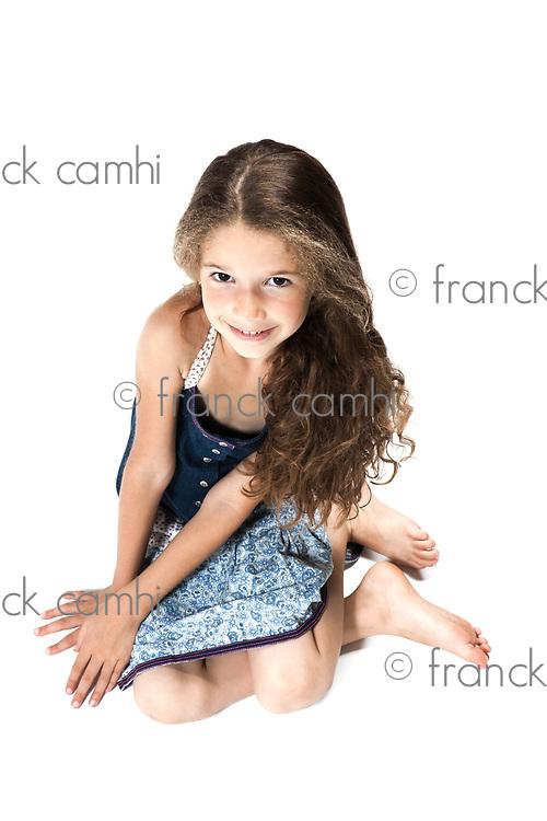 caucasian little girl smiling seductive isolated studio on white background
