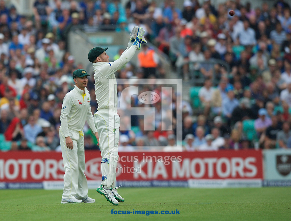 wicketkeeper Peter Nevill of Australia catches the ball watched by Captain Michael Clarke of Australia during the 5th Investec Ashes Test match at the Kia Oval, London<br /> Picture by Alan Stanford/Focus Images Ltd +44 7915 056117<br /> 23/08/2015