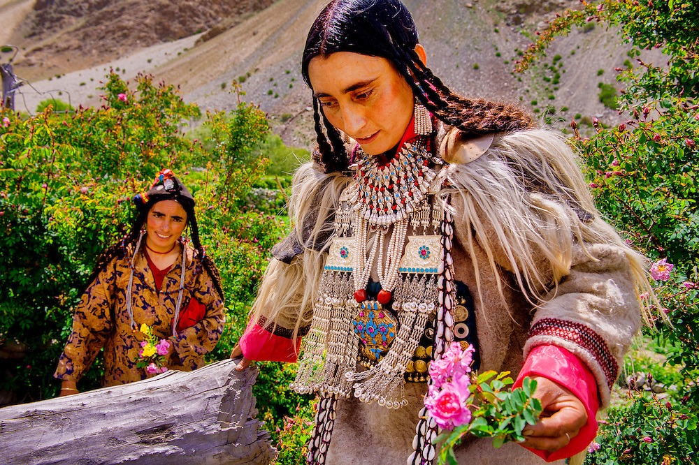 Two women plucking the flowers which they would use in decoration of their headgear, its a  part of their day-to-day routine but in this case they are getting ready for a festival in which they would perform traditional dance.