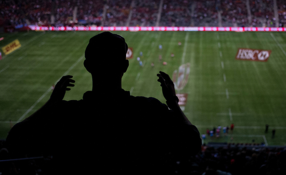 A silhouetted fans cheers from the upper deck at the HSBC Sevens World Series XVII Round 6 at B.C. Place Stadium in Vancouver British Columbia on March 13, 2016. Canada won the match 17-7.  (KevinLight/CBCSports)