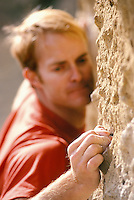A closeup view of a mans hand as he grips a edge on a rock wall while climbing at Smith Rock State Park, Oregon, USA.