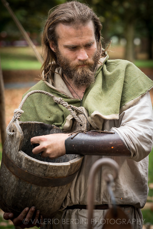 A smith takes coal to the furnace. It's been 950 years since King Harold got an arrow in the eye at the Battle of Hastings. A group of re-enactors set up a camp near Apsley House in Hyde Park, London, to show their weapons, games and living arrangements.
