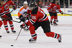 Jan 21; Newark, NJ, USA; New Jersey Devils right wing Petr Sykora (15) skates with the puck during the first period of their game against the Philadelphia Flyers at the Prudential Center.