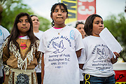 23 APRIL 2012 - PHOENIX, AZ:  Children lead a prayer  at the Arizona State Capitol Monday. About 200 high school students from across the Phoenix metropolitan area rallied at the Arizona state capitol in Phoenix Monday to show their opposition to Arizona's tough anti-immigration law, SB 1070. April 23 is the 2nd anniversary of the law's signing. The US Supreme Court is taking up the law during a hearing Wednesday, April 25 in Washington DC.        PHOTO BY JACK KURTZ