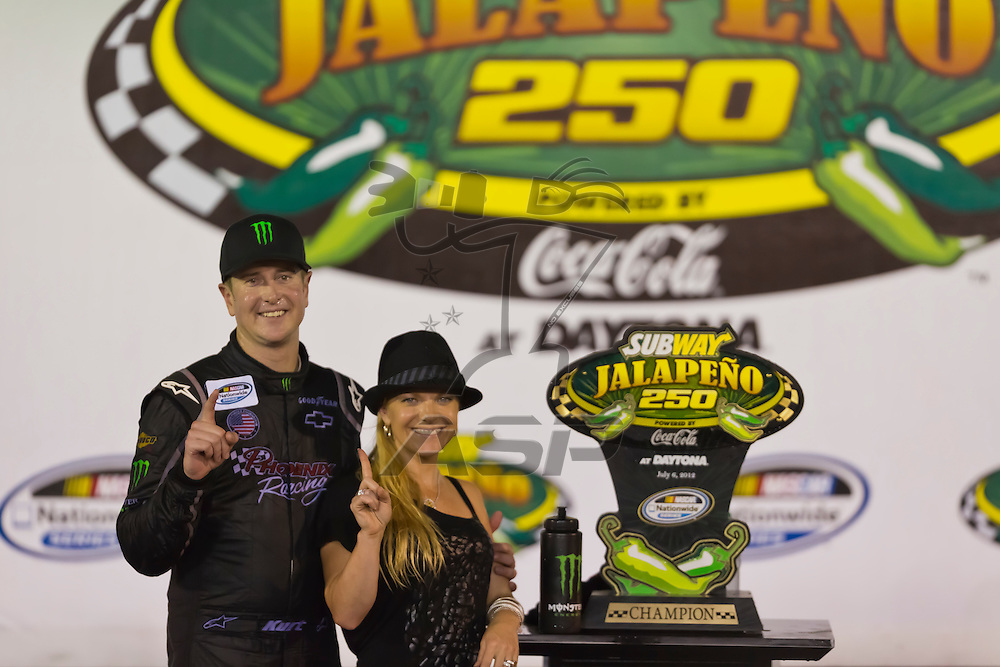 DAYTONA BEACH, FL - JUL 06, 2012:  Kurt Busch (1) holds off the rest of the field to win the Subway Jalapeno 250 at the Daytona International Speedway in Daytona Beach, FL.