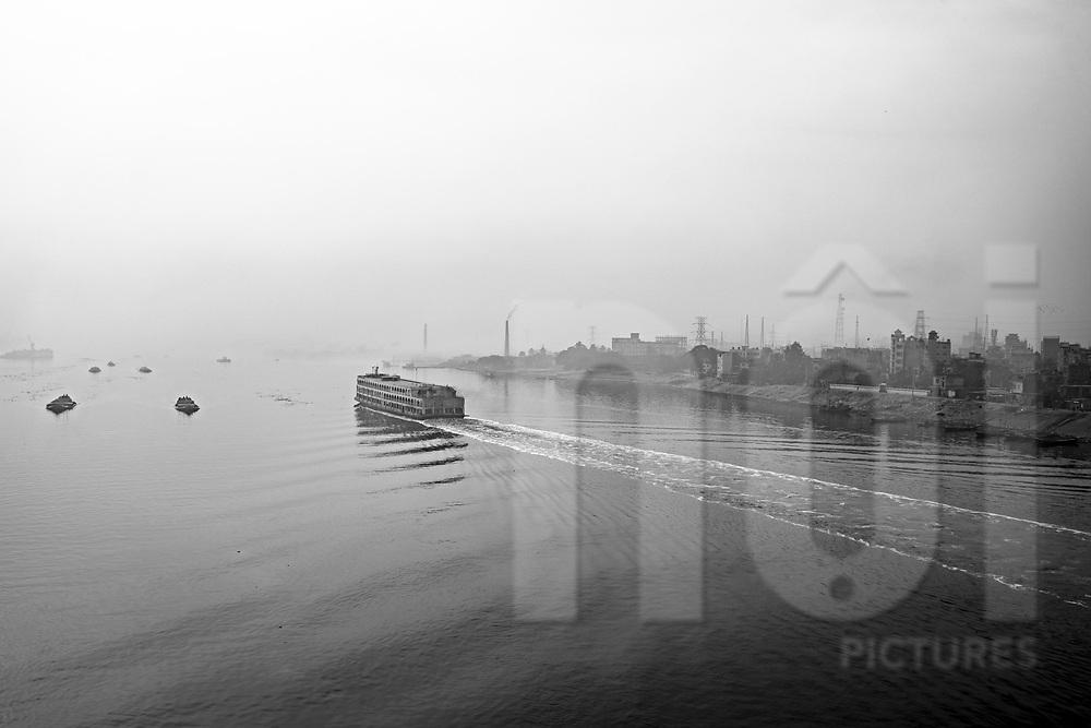 Ferry sails on Buriganga River, Dhaka, Bangladesh, Asia