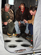 Ice fishing for trout on a small pothole lake in Wisconsin