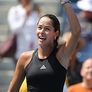Ana Ivanovic, Serbia, hits balls into the crowd after her victory  over Alison Riske, USA, during the US Open Tennis Tournament, Flushing, New York, USA. 26th August 2014. Photo Tim Clayton
