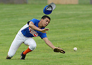 Chester's Saxon Smith loses his hat while trying to make a catch during a District 19 Junior boys' baseball game at the Town of Wallkill on Friday, July 17, 2009.