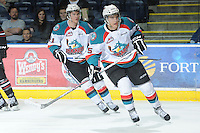 KELOWNA, CANADA - FEBRUARY 18: Colton Heffley #25 and Brett Lyon #21 of the Kelowna Rockets skate on the ice against the Red Deer Rebels at the Kelowna Rockets on February 18, 2012 at Prospera Place in Kelowna, British Columbia, Canada (Photo by Marissa Baecker/Shoot the Breeze) *** Local Caption ***