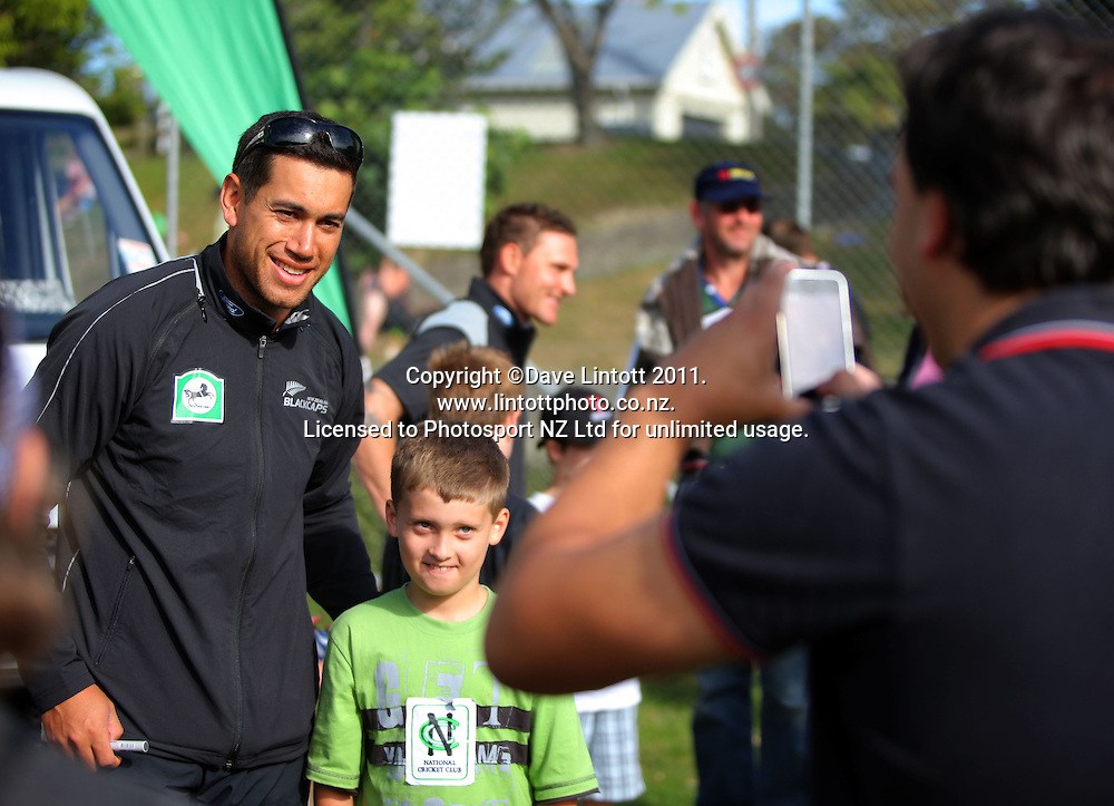 Ross Taylor poses for a photo with a young fan. NCC cricket supercamp at Anderson Park, Wellington, New Zealand on Thursday, 13 January 2011. Photo: Dave Lintott / photosport.co.nz
