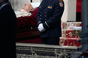 March 10, 2015 - New York, NY. Former Cardinal Edward Egan lies in state as a member of his honor guard stands watch during the wake. 2/10/2015 Photo By Paul Liotta/NY City Photo Wire