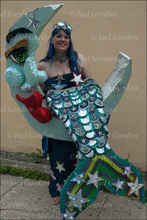 Mermaid Parade marcher as Crescent Moon Mermaid in colorful costume  before the start of the parade in Coney Island.