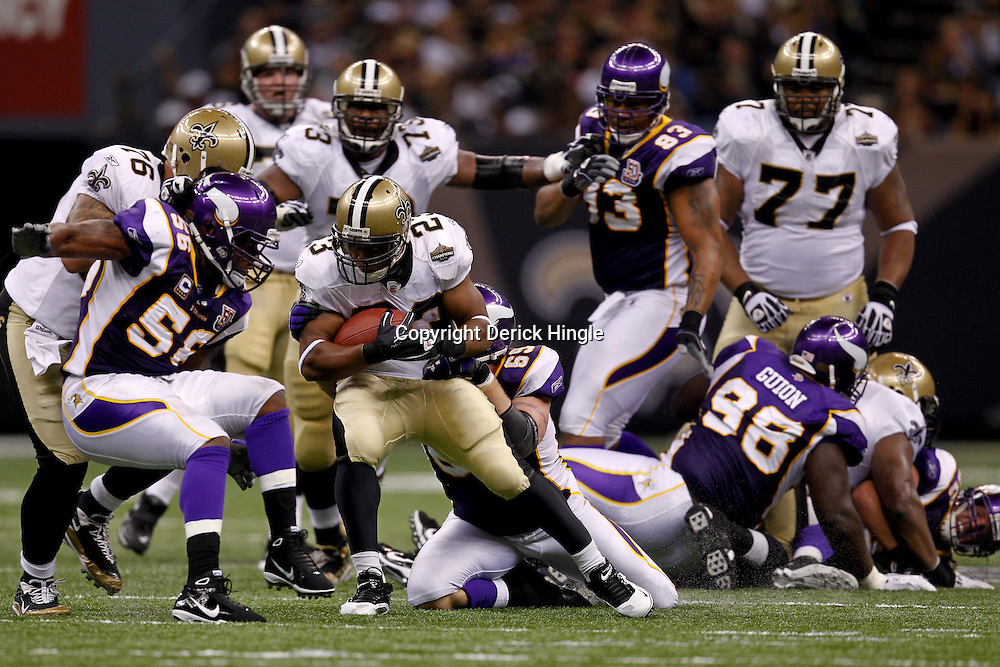 September 9, 2010; New Orleans, LA, USA;  New Orleans Saints running back Pierre Thomas (23) is tackled by Minnesota Vikings defensive end Jared Allen (69) and Minnesota Vikings linebacker E.J. Henderson (56) during the NFL Kickoff season opener at the Louisiana Superdome. The New Orleans Saints defeated the Minnesota Vikings 14-9.  Mandatory Credit: Derick E. Hingle