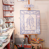 A display of decorative tiles and household items at Colette Ripley's ceramic workshop and boutique located in the Panier neighborhood of Marseille, France.