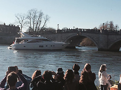 """© Licensed to London News Pictures. 16/03/2014. Richmond, UK The pleasure cruiser """"The Victoria"""" crashes into Richmond Bridge in surrey today 16th March. There was considerable damage to the vessel. The boat eventually made it through the bridge to cheers from crowds who were enjoying the sunny weather along the River Thames. . Photo credit : Michael Traboulsi/LNP"""