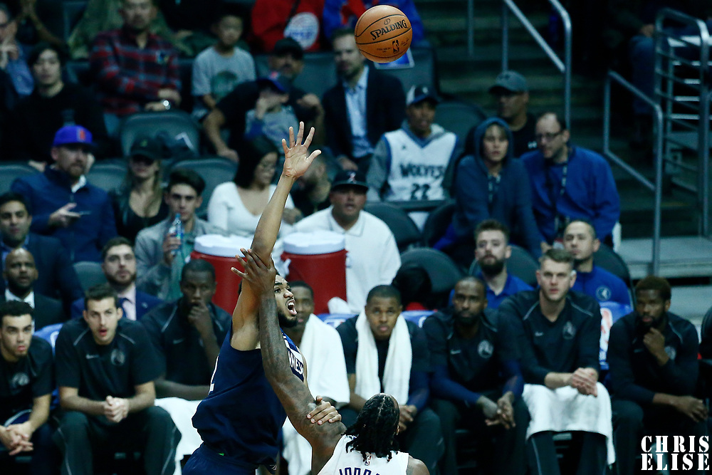 06 December 2017: Minnesota Timberwolves center Karl-Anthony Towns (32) goes for the baby hook over LA Clippers center DeAndre Jordan (6) during the Minnesota Timberwolves 113-107 victory over the LA Clippers, at the Staples Center, Los Angeles, California, USA.